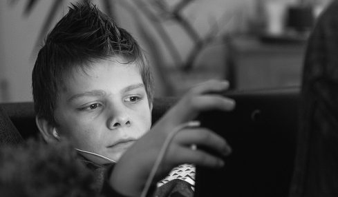 kid playing games on a laptop